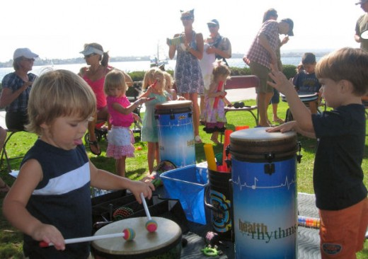 Beat it, kid!  Kids' drum circles on Kids Walk are led by Susan Hall of Rhythm Worx, and they're a blast.