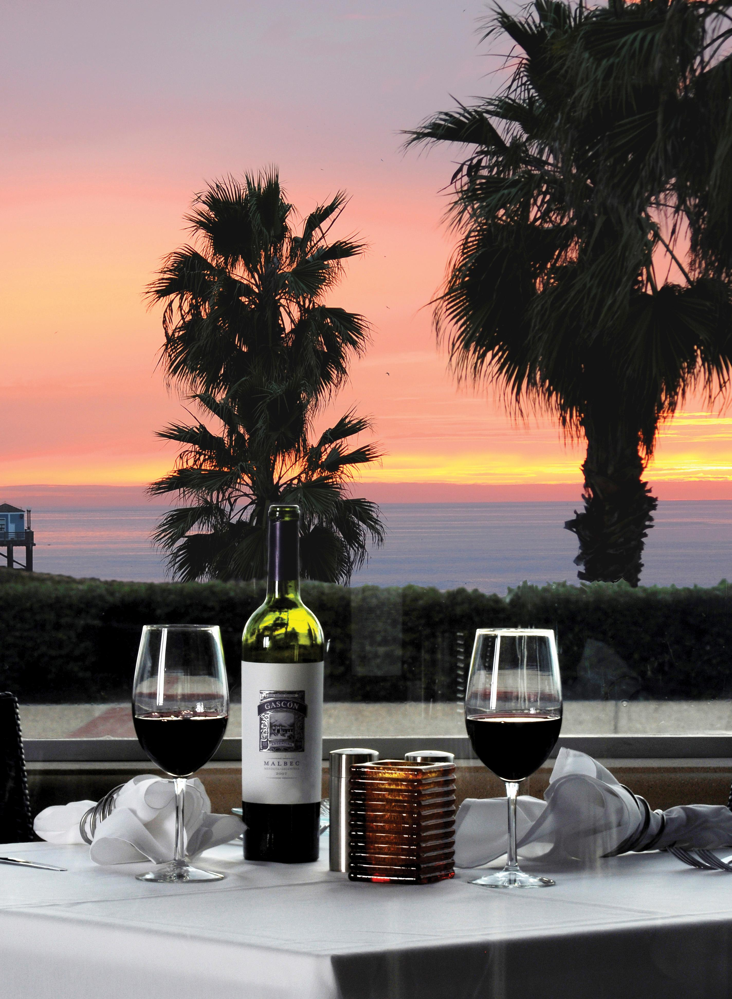 333 Paficic's classic Surf-n-Turf offerings come with a magificent sunset view.