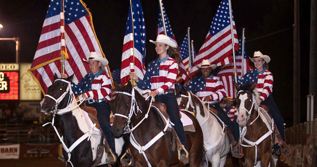 Girls Carrying Flags on top of Horses at the Poway Rodeo