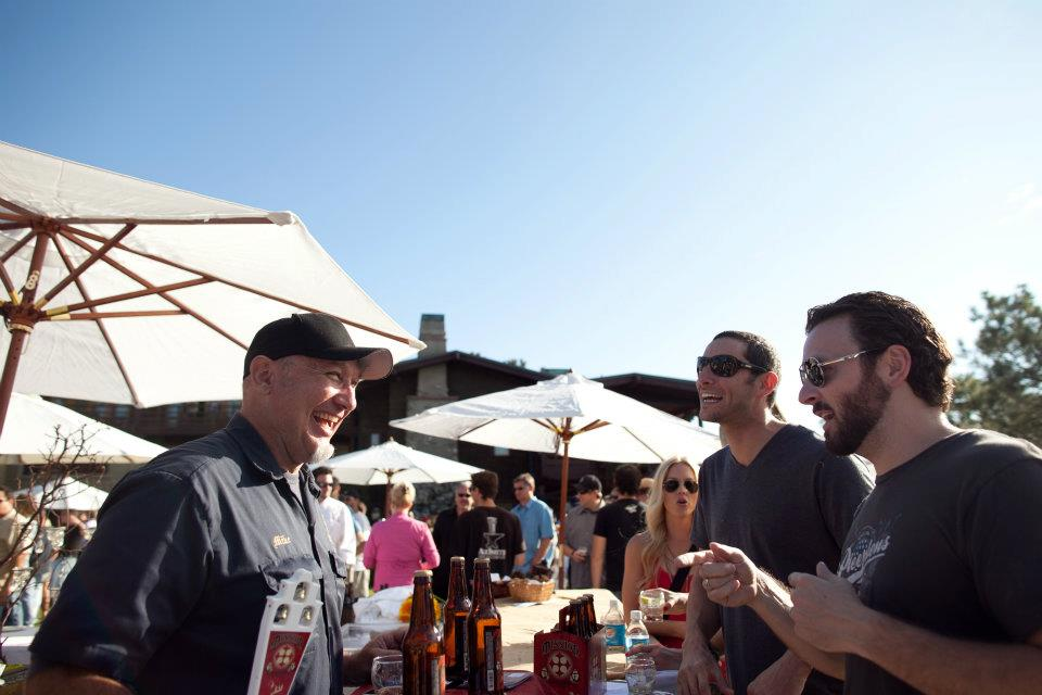 Beer Garden attendees talking to a brewer during San Diego Beer Week Beer Garden