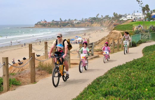 Enjoy a family ride along the Pacific Beach Boardwalk. Photo courtesy Brett Shoaf Artistic Visuals