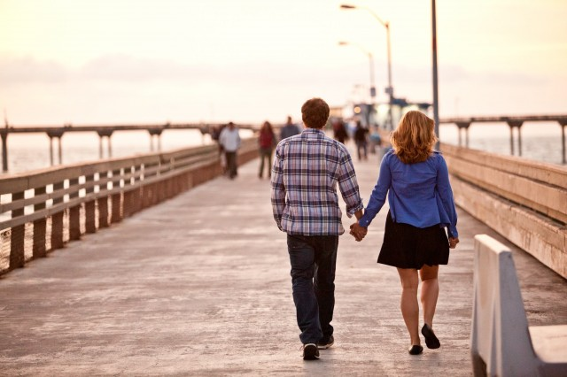 Couple Walking on Ocean Beach Pier