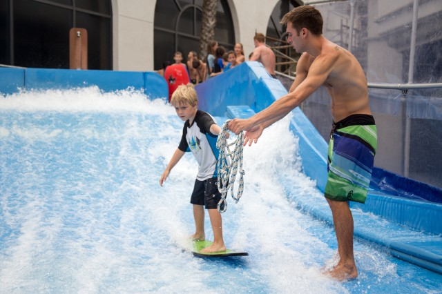 Learning to surf the Flow Ride Wave Machine at Belmont Park is just one of the fun activities in this summer day camp on the beach.
