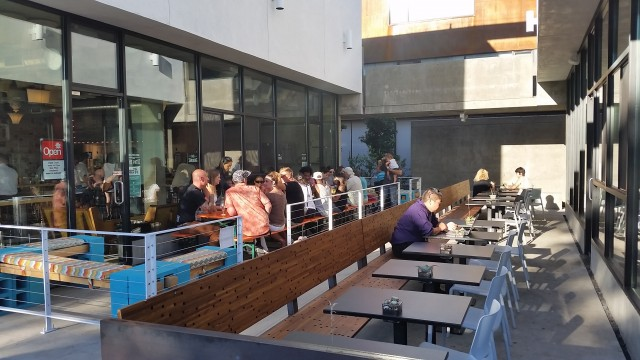 Modern Times Flavordome Brewery Tasting Room patio meets Influx Cafe patio at The North Parker building on 30th and Upas Streets.
