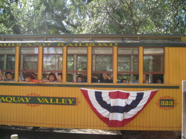 My daughter rides the rails at a train-themed birthday party at Old Poway Park.
