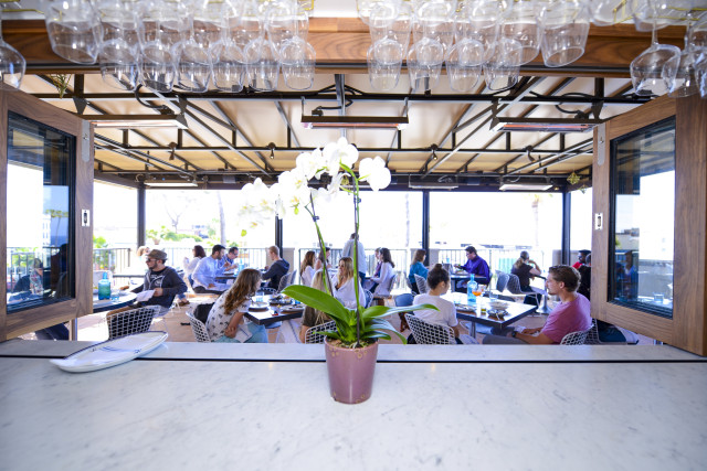 People watching is always in style at the hip new Catania restaurant high atop La Plaza La Jolla.