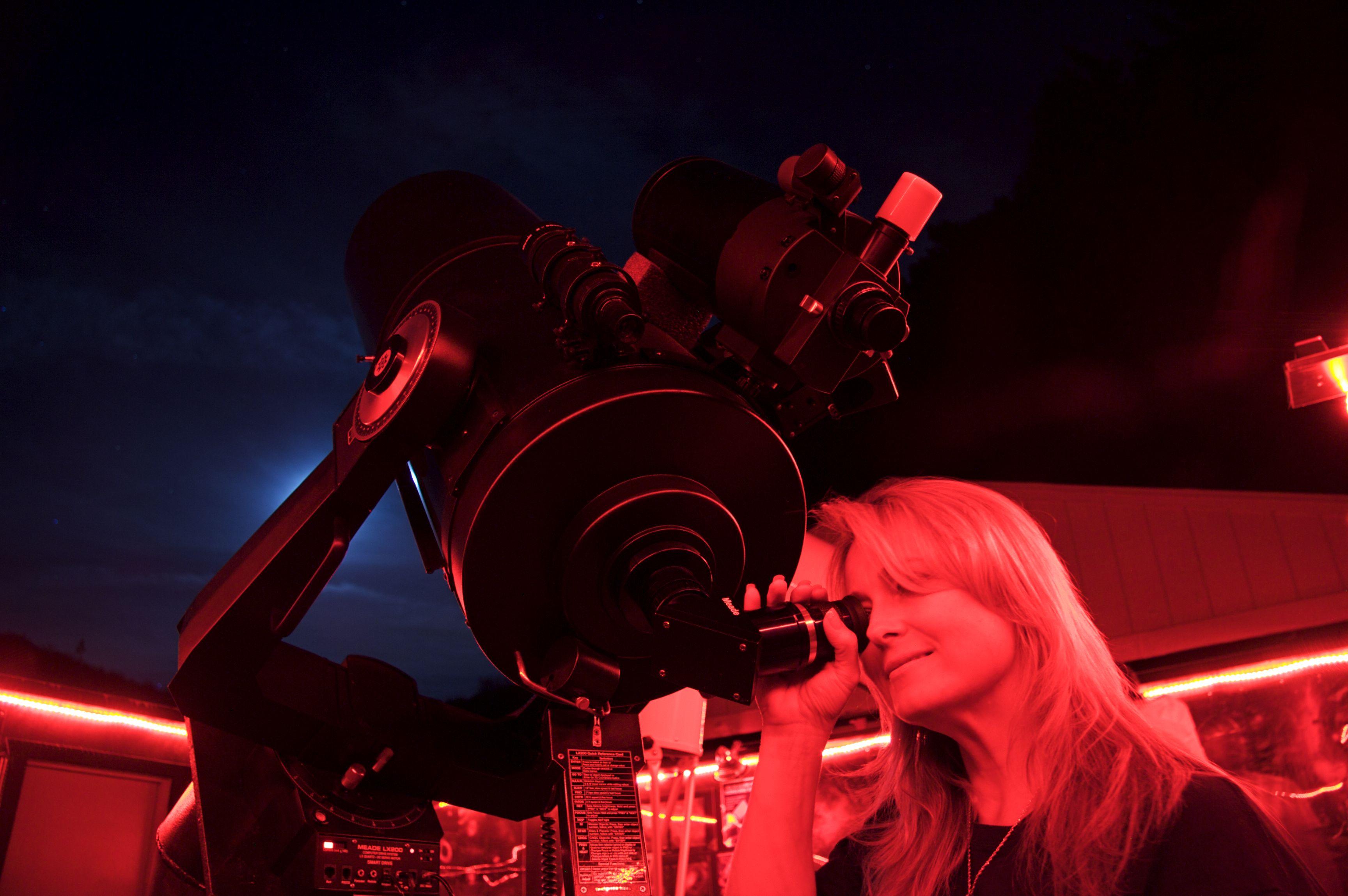 Woman Looking Through a Telescope
