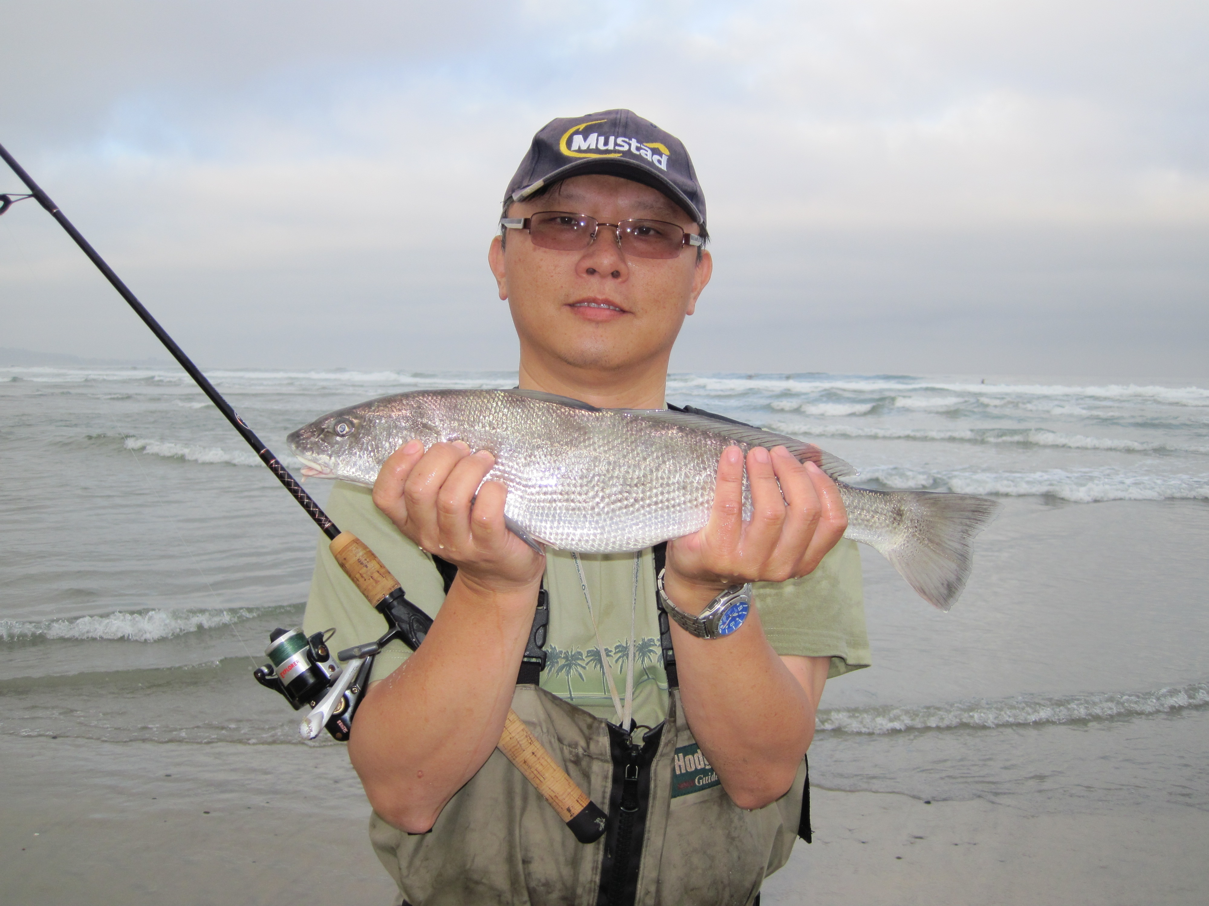 Man with his catch after surf fishing