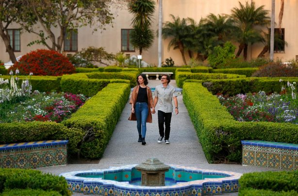 Couple walking in Balboa Park's Alcazar Garden