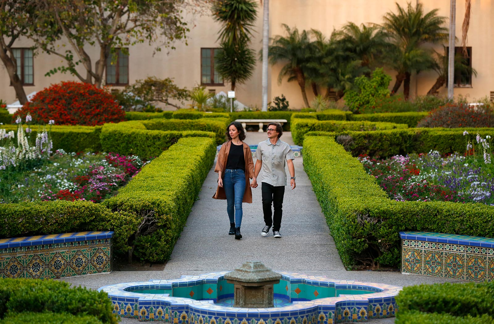 Couple walking in Balboa Park's Alcazar Garden