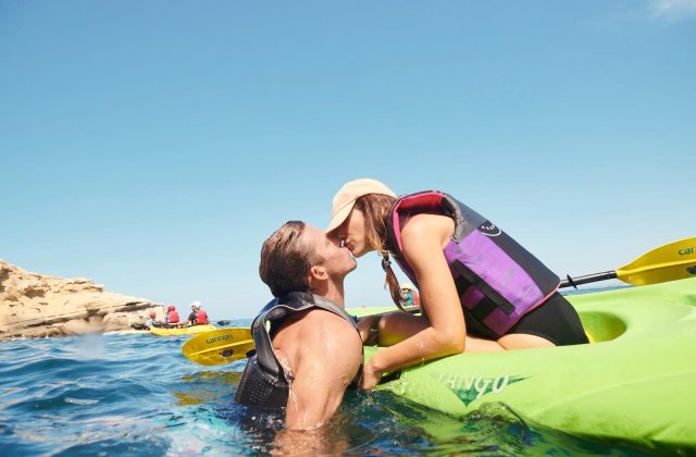 Couple on a Kayak Kissing - Top Things to Do in San Diego