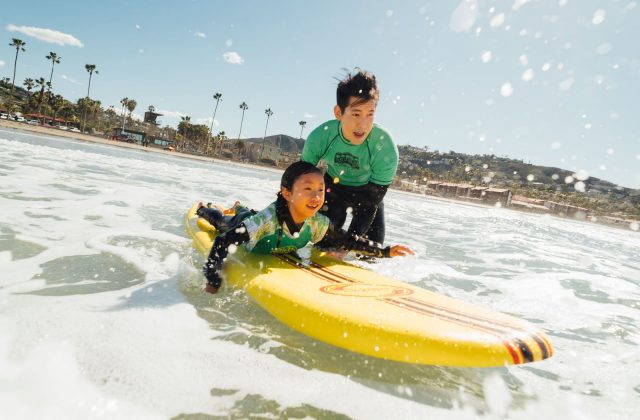 Father and Daughter Learning to Surf - Top Things to Do in San Diego