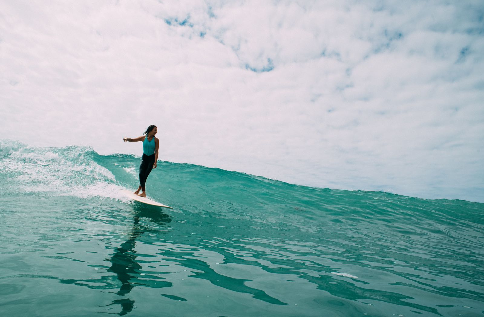 Woman on a surfboard - Top Things to Do in San Diego