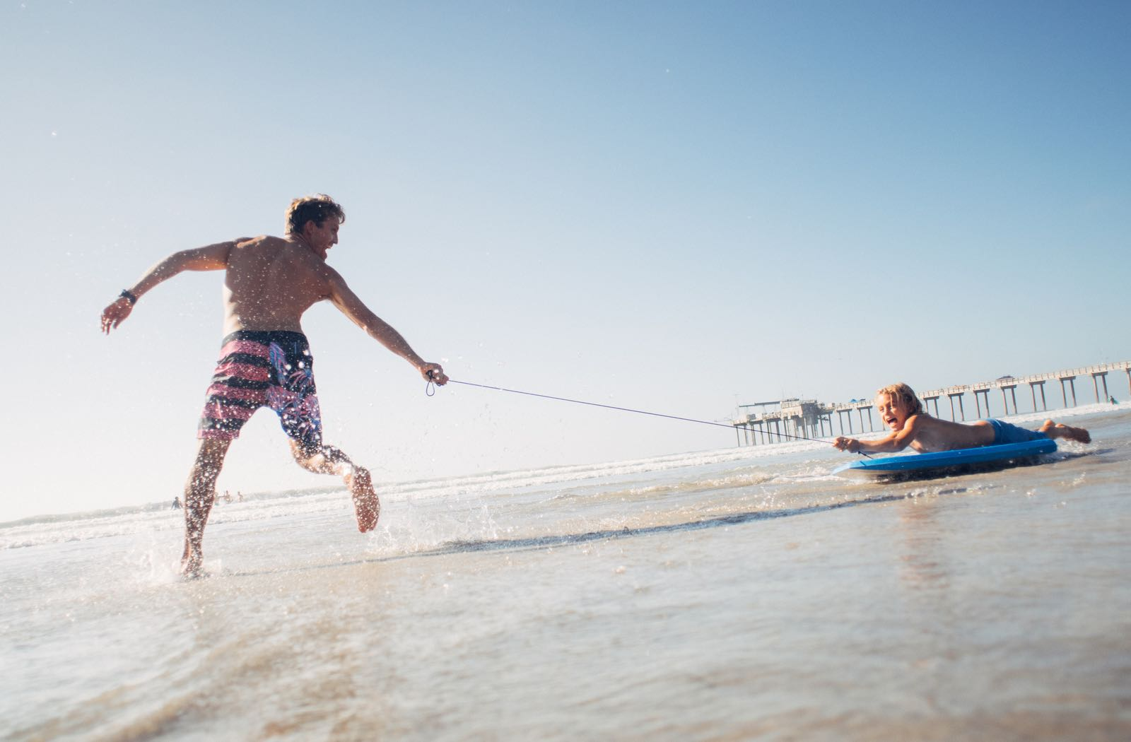 Father and Son playing on the beach - Top Things to Do in San Diego