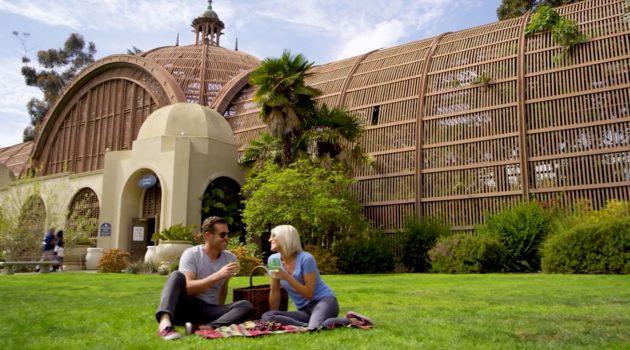 man and woman enjoying a picnic at balboa park